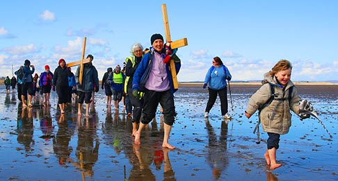 Pilgrims walk across a tidal causeway while carrying crosses during the final leg of the Northern Cross pilgrimage to Holy Island in northern England, March 29. For more than 30 years Christians have taken part in the pilgrimage to Holy Island, walking through Northumberland and along the Scottish border during Holy Week.