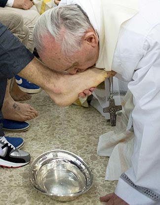 Pope Francis kisses the foot of a prison inmate during the Holy Thursday Mass of the Lord's Supper at Rome's Casal del Marmo prison for minors March 28. The pope washed the feet of 12 young inmates, including at least two Muslims and two women. He told them that, just as Jesus came to serve, he too was at their service. While the prison Mass was a first for the modern papacy, the practice was nothing new to Pope Francis who, as archbishop of Buenos Aires, used to celebrate the Mass of the Lord's Supper in prisons, hospitals or shelters for the poor and marginalized.