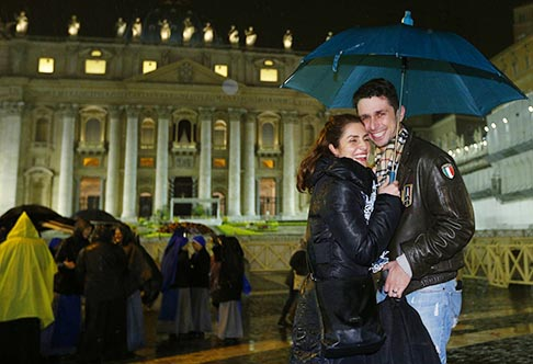 Patrizia Piredda and Nicola Medas are pictured moments after becoming engaged in St. Peter's Square after attending the Easter Vigil in the basilica March 30.