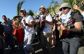Christians sing and dance as they celebrate Palm Sunday on the Mount of Olives.