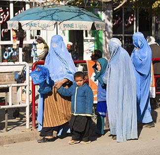 Afghan women with their children go shopping in Fayzabad, Afghanistan.