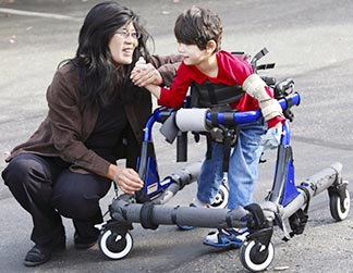A mother's love sees what her child can do, despite his disability walker.