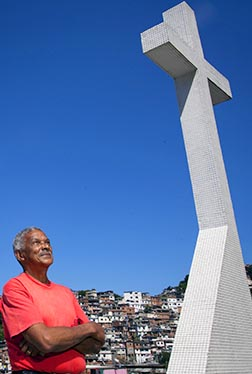 Carlos Rojas and the hillside slum of Vidigal are seen from Our Lady of Consolation Church in Rio de Janeiro.