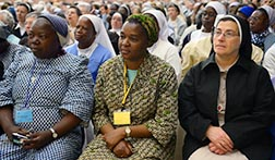 Women religious listen as Pope Francis addresses members of the International Union of Superiors General at the Vatican May 8.