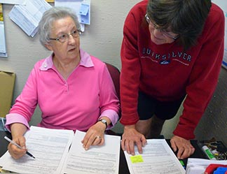 Sr. Diane Brennan (left) works at her Changing Together office, assisted by Karen Sigurdson.