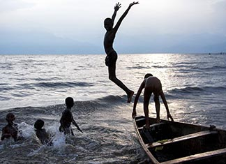 Boys from Bujumbura, Burundi, take a dip at sunset in Lake Tanganyika.
