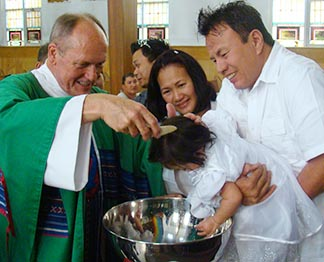 Fr. Paul Kavanagh says a Baptism service spreads joy in parishoners' faces.