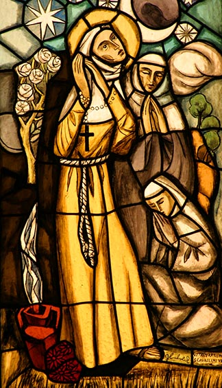 St. Clare of Assisi is depicted in a stained-glass window inside the Church of San Damiano.