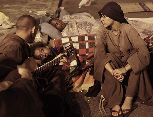 Members of the Franciscan community O Caminho (The Way) play religious music in the Campo Grande neighbourhood of Rio de Janeiro April 17. The community helps the homeless on the city's streets.