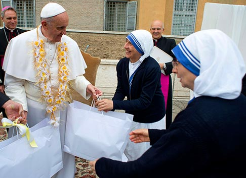 Pope Francis talks with members of the Missionaries of Charity during a visit to a soup kitchen and women's shelter at the Vatican May 21. The facility is inside the Vatican walls; it serves meals to about 60 people each day and offers accommodation to 25 women.