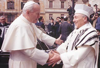 Pope John Paul II greets Rabbi Elio Toaff at Rome's main synagogue April 13 1986. The meeting marked the beginning of a new era in Catholic-Jewish relations. It was the first time a pope had entered the Rome Synagogue.