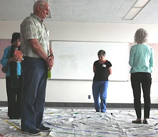 Pastoral workers from various parishes in the Edmonton Archdiocese make their way through an indoor labyrinth as part of the annual Pastoral Assistants day May 30.