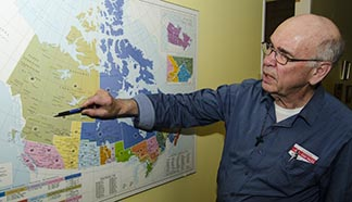 Fr. Joe Daley points out some of the places he's been in Canada's North.