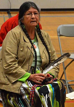 Mary Moonias held an eagle feather as she testified before the Truth and Reconciliation Commission in Red Deer June 6.