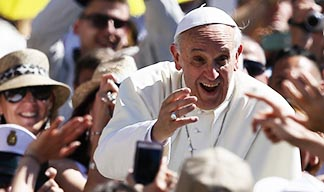 Pope Francis greets pilgrims as he arrives for his weekly general audience in St. Peter's Square at the Vatican June 12.