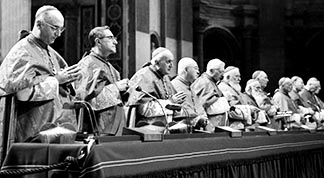 The presidents of the Second Vatican Council are pictured during a council session inside St. Peter's Basilica.