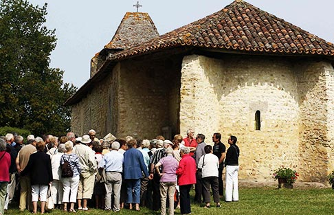 Tourists gather outside the Notre Dame des Cyclistes (Our Lady of Cyclists) chapel near the village of Labastide-d'Armagnac in southwestern France June 27. The chapel was declared a national shrine for cycling and cyclists under the protection of Mary by Pope John XXIII. It is a popular stop for pilgrims who cycle through France on their way to Santiago de Compostela in Spain.