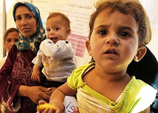 Syrian refugee families await treatment at a medical centre at the Al Zaatri refugee camp in Mafraq, Jordan, June 11.