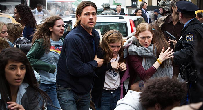 Brad Pitt, Abigail Hargrove, centre, and Mireille Enos star in a scene from World War Z.