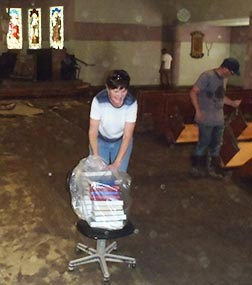 The volunteers from central Alberta emptied out the devastated High River church to make way for future renovations.