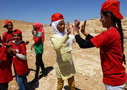 Girls from the South Hebron Hills play a game at a summer camp in the West Bank village of Tuba June 28. A nongovernmental organization runs the program for Palestinian children with help from volunteers with Operation Dove, the nonviolent peace corps of the Italian-based Pope John XXIII Community.
