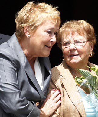 Quebec Premier Pauline Marois (left) comforts a mourner following a memorial service to honour the victims of the train derailment in Lac Megantic, Que., on July 27.