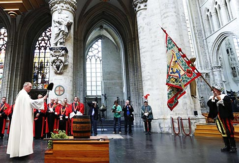 A priest blesses a barrel of beer as members of the Knighthood of the Brewers' Mash staff take part in celebrations at the cathedral in Brussels Sept. 6. The celebration takes place during the annual September beer weekend.