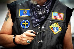 Charlie Hoy, a member of the Knights on Bikes, proudly displays patches on his vest.