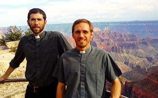 Fr. Ignacio Llorente and Fr. Lucas Laborde stand in front of the Grand Canyon in Arizona.