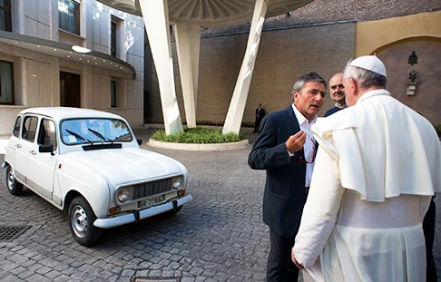 Pope Francis walks outside to accept a gift of a 1984 Renault at the Vatican Sept. 7. The silver-white four-door vehicle with 300,000 km was donated by Fr. Renzo Zocca, 70, of Verona, Italy, who took the pope for a ride around the Vatican in the car.
