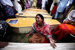 A woman mourns next to the coffin of her brother who was killed in a suicide attack at All Saints Church in Peshawar, Pakistan, Sept. 22.