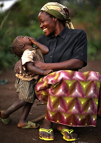 Sr. Angelique Namaika embraces a child at a site for internally displaced people in Congo.