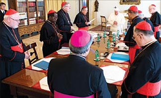 Pope Francis prays during a meeting with his Group of 8 cardinals at the Vatican Oct. 1. In a newspaper interview, the pope said the meeting marks 'the beginning of a Church that is not just top-down, but also horizontal.'
