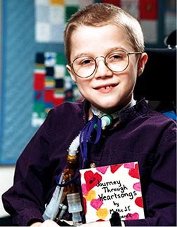 Mattie Stepanek, who died in 2004 after battling a rare form of muscular dystrophy, is pictured with one of his five best-selling books of poetry.