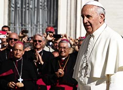 Bishops watch as Pope Francis arrives to lead his general audience in St. Peter's Square at the Vatican Oct. 2.
