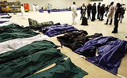 Body bags containing African migrants, who drowned trying to reach Italian shores, lie in a hangar of the Lampedusa airport in Italy Oct. 3.