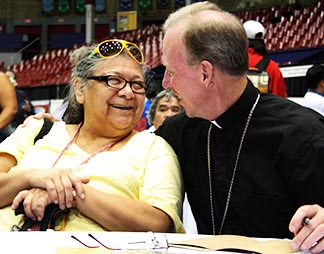 Bishop Gary Gordon of Whitehorse shares a laugh with an aboriginal woman during the Truth and Reconciliation Commission's event in Vancouver.