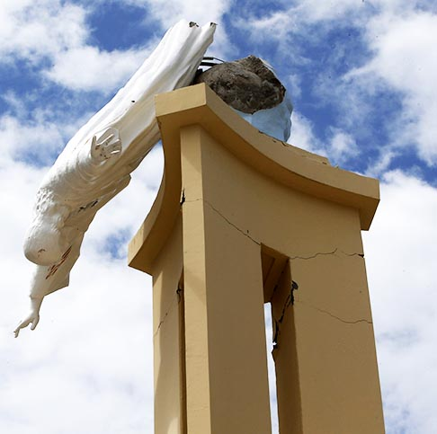 A statue of Christ hangs from a portion of the destroyed Our Lady of Light Church in Bohol, a day after a magnitude 7.1 earthquake struck central Philippines. Many people throughout the region remained outdoors the night of Oct. 15 because they feared aftershocks.