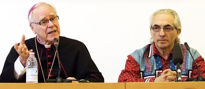Archbishop James Weisgerber speaks alongside Phil Fontaine, then-leader of the Assembly of First Nations, during a 2009 news conference in Rome.