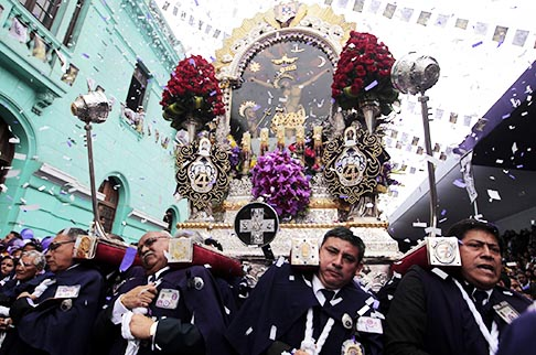 Men carry a replica of Peru's most revered religious icon, the Lord of Miracles, during a procession in Lima Oct. 28. The procession, which draws the largest gathering of believers on the continent, can be traced to the colonial era.