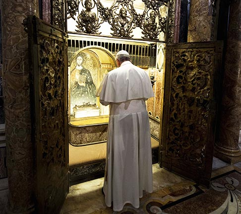Pope Francis prays at the tomb of St. Peter inside St. Peter's Basilica at the Vatican Nov. 2, All Souls' Day.