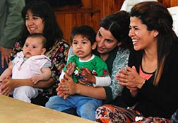 Young mothers gather at a church in Buenos Aires to discuss with Gravida volunteers topics ranging from diaper changes and pacifiers.