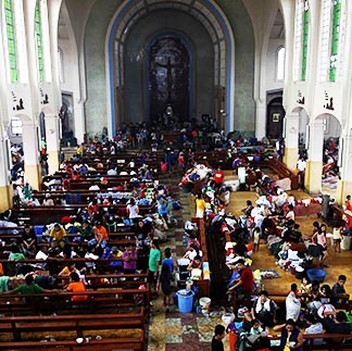 Residents seek refuge inside a Catholic church converted into an evacuation centre Nov. 10 in Tacloban, Philippines.