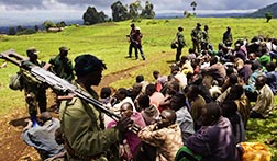 Congolese soldiers guard suspected M23 rebel fighters who surrendered near Goma, Congo, Nov. 5.