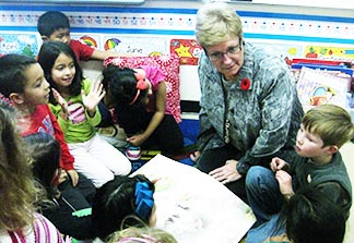 Marcia Dolinski, chaplain at Holy Family Elementary/Junior High, works with Grade 2 students.
