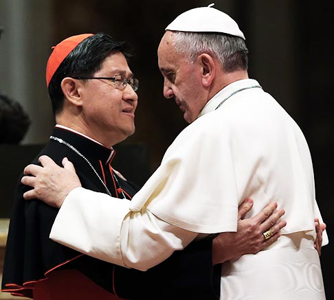 Pope Francis embraces Cardinal Luis Antonio Tagle of Manila before blessing a mosaic of St. Pedro Calungsod during a meeting with the Philippine community at St. Peter's Basilica at the Vatican Nov. 21. St. Pedro Calungsod was a lay catechist from the Philippines who was martyred in Guam in 1672.