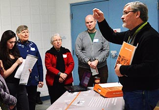Ray Berkenbosh, a King's College professor, leads one of the meeting's resources stations.