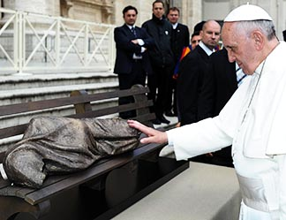 Pope Francis blesses Timothy Schmalz's Jesus the Homeless sculpture.