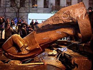 People surround a statue of Soviet state founder Vladimir Lenin, which was toppled by protesters during a Dec. 8 rally organized by the European Union integration in Kyiv, Ukraine.