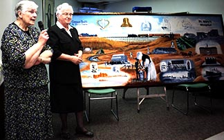 Sisters Ann Yuhas and Therese Verrier witnessed the unveiling of an historical painting depicting moments of their work.